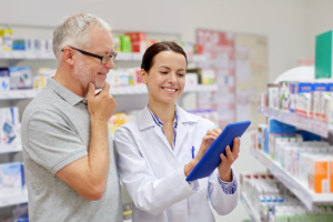 pharmacist talking to the old man customer